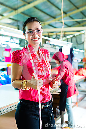 Free Asian Dressmaker In A Textile Factory Stock Photo - 29525030