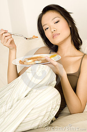 Asian Eating Breakfast