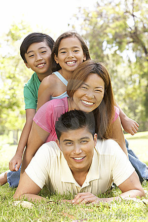 Asian Family Enjoying Day In Park Stock Photography - Image: 12405292