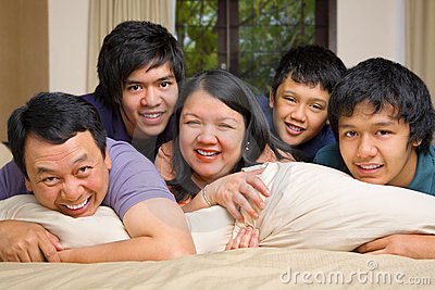 Asian family lifestyle portrait in bedroom