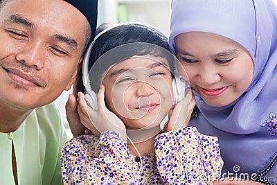 Asian family listen mp3 headphone