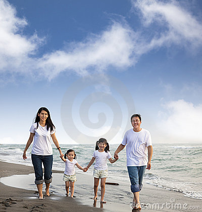 Asian Family walking On the  Beach