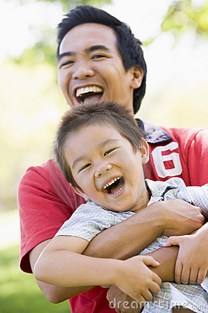 Free Asian Father And Son Having Fun In Park Royalty Free Stock Images - 4849829