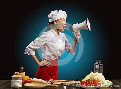 Asian female chef shouting into a megaphone