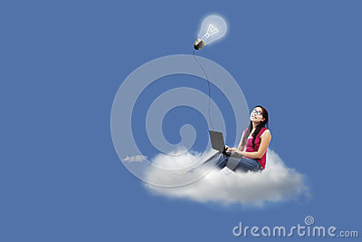 Asian female on cloud with laptop and lamp
