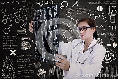 Asian female doctor hold x-ray in lab