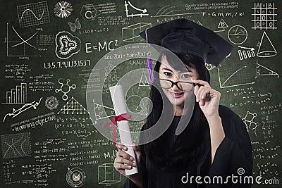 Asian female graduate in class with certificate