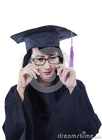 Asian female graduate crying - isolated