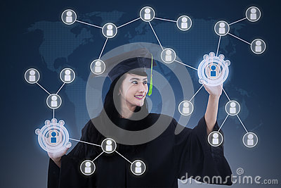Asian female graduate networking touchscreen