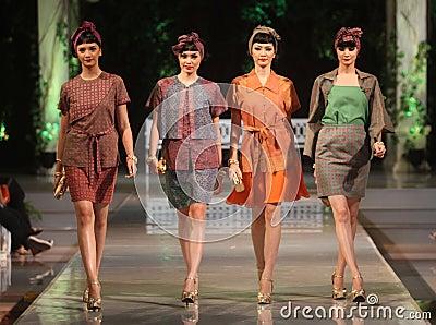 Asian female model wearing batik at fashion show runway Editorial Photo