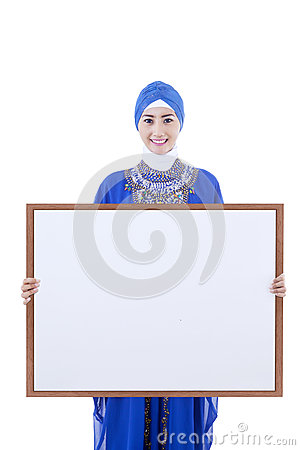Asian female muslim hold copyspce board - isolated
