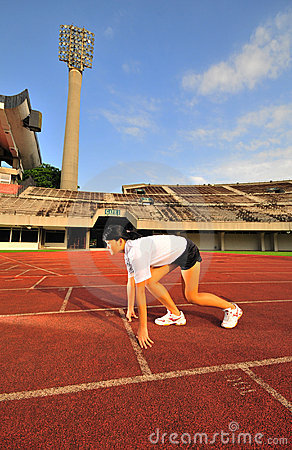 Asian Female preparing to race on track