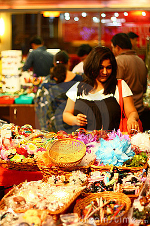 Asian Female Selecting Clothing Accessories