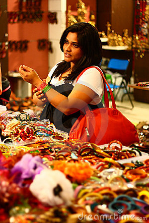 Asian Female Selecting Colorful Bangles
