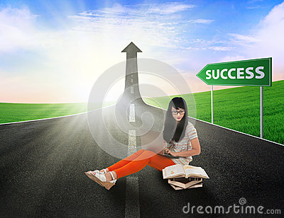 Asian female student study on road of success