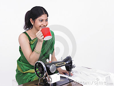 Asian female tailor drinking tea