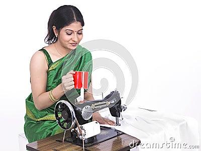 Asian female tailor drinking tea