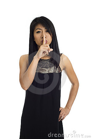 Asian with finger on her lips