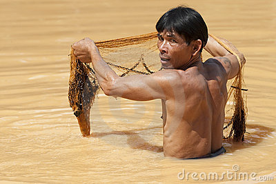 Asian fisherman with throw net