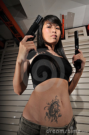 aSIAN Gangster Girl holding two guns