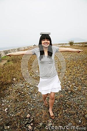 http://thumbs.dreamstime.com/x/asian-girl-balancing-book-head-1954275.jpg