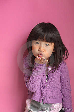 Asian Girl blowing a kiss