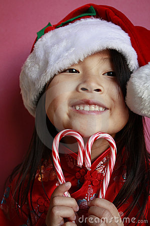Asian Girl With Candy Canes And Santa Hat Royalty Free Stock Image - Image: 12197146