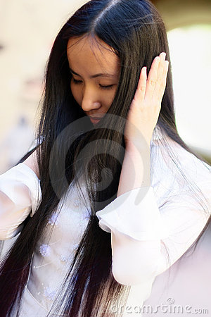 Asian girl covered ears with her hands