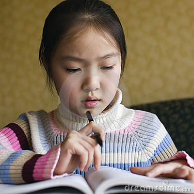 Free Asian Girl Doing Homework Royalty Free Stock Photos - 9670168
