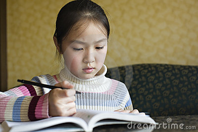 Asian girl doing homework