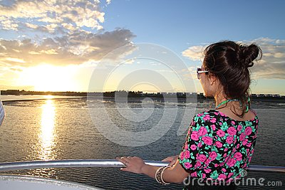 An asian girl enjoying sunset