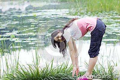 Asian girl exercise in park