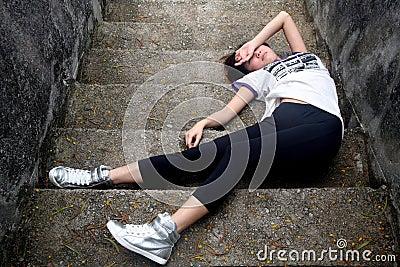 Asian girl fallen down steps