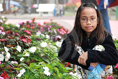 Asian girl at a flower garden