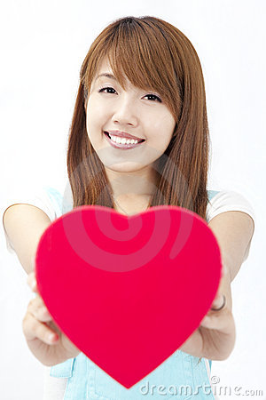 Asian girl  giving red heart gift