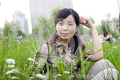 Asian girl in grassland