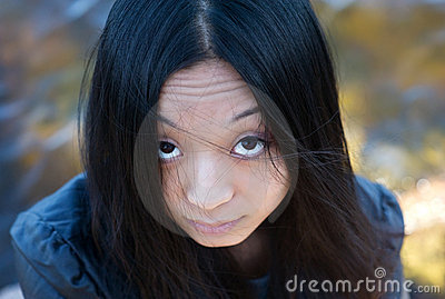 Asian girl with hair on face