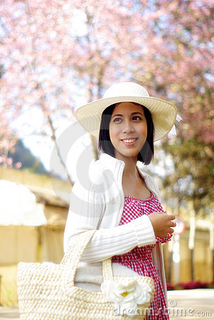 ASIAN GIRL WITH HANDBAG IN THE COUNTRYSIDE