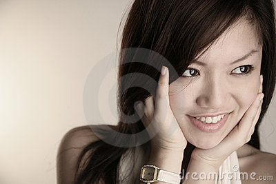 Asian girl with hands on face