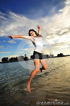 Asian Girl having Fun at the Beach