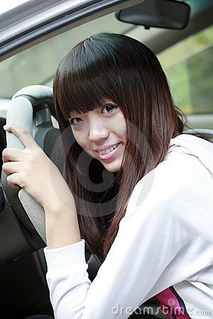 Asian girl with her car