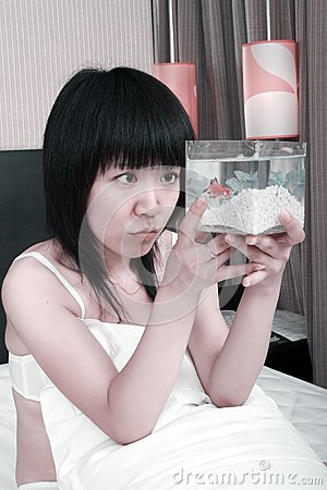 Asian girl with her goldfish