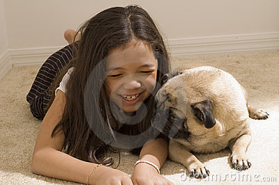 Asian Girl with Her Pet Pug