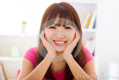 Asian girl holding her face