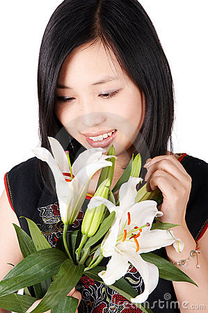 Asian girl holding lily