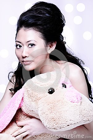 Asian girl holding stuff animal
