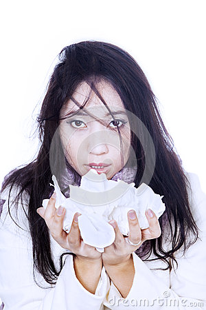 Asian girl holding tissue isolated in white