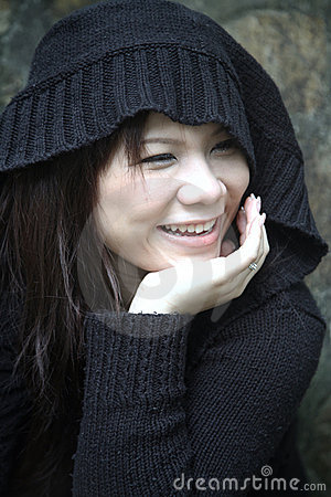 Asian girl in a hood smiling