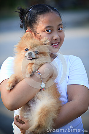 Asian girl hug pomeranian dog