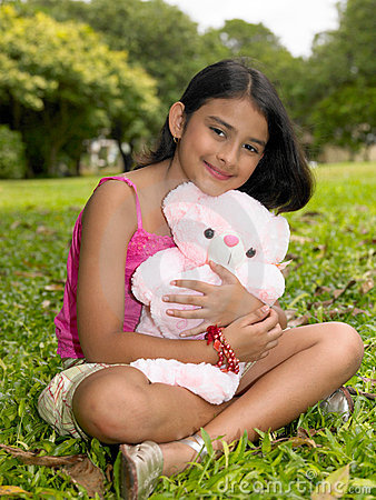 Free Asian Girl In The Garden With Her Pink Teddy Bear Stock Photos - 7878663